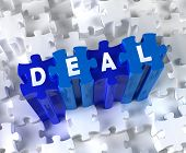 Creative 3D pieces of puzzle and word DEAL