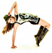 foto of tween  - Beautiful Tween Girl Dancing Hip Hop in Studio Over White - JPG