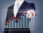 business and technology concept - businessman hand with chart on virtual screen