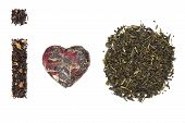 stock photo of black tea  - I love tea made of black earl grey tea compressed green tea and dry tea leaves. Tea time conceptual background.