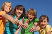 Group Of Tweens With Thumbs Up