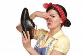 image of smelly  - beautiful vintage housekeeper holding a smelly shoes with facial expression on white - JPG