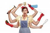 stock photo of housekeeper  - pretty very busy multitasking housewife on white background - JPG