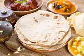 Chapati, Chapatti or Flat bread and Indian dhal curry, famous Singapore Indian food.
