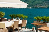 Restaurant Tables On The Mediterranean Sea