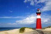 Lighthouse on the blue sky background.