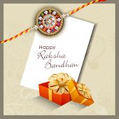 Indian festival background with beautiful rakhi and gift boxes.