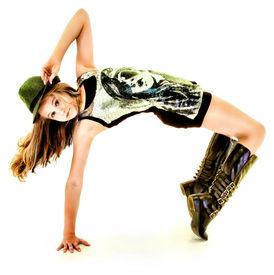 picture of tween  - Beautiful Tween Girl Dancing Hip Hop in Studio Over White - JPG