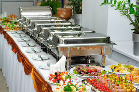 stock photo of chafing  - banquet table with chafing dish heaters and canapes - JPG