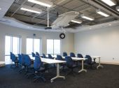 stock photo of training room  - Training Room with Airplane Wing Hanging from the Ceiling - JPG