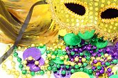 stock photo of beads  - Mardi Gras mask with beads and doubloons
