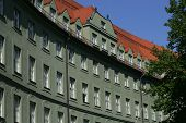 stock photo of gabled dormer window  - Curved building with rows of windows in Munich - JPG