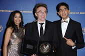 Freida Pinto with Danny Boyle and Dev Patel in the press room at the 61st Annual DGA Awards. Hyatt Regency Century Plaza, Los Angeles, CA. 01-31-09