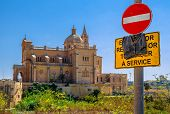 Basilica Of Ta Pinu Behind Sign