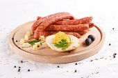 Wooden Chopping Board With Sausages, Cheese, Bread