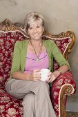 Middle Aged Woman With Cup Of Coffee