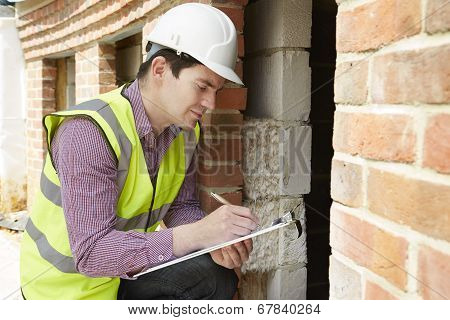 Architect Checking Insulation During House Construction poster