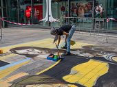 Street Painter At Work