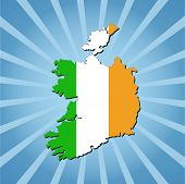 stock photo of irish flag  - Ireland map flag on blue sunburst illustration - JPG