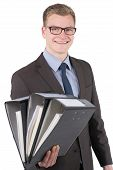 Young Man Is Holding Several Files