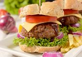 stock photo of beef-burger  - Bug and juicy beef burger and vegetables - JPG