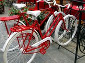WROCLAW, POLAND - JUNE 07, Two Bikes For Women And Men, Painted White And Red Standing In A Rack