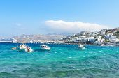 Small Fishing boats and traditional houses in the background in the Famous Mykonos Island