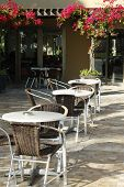 Tables and chairs at mediterranean outdoor cafe
