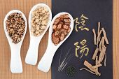 Chinese herbal medicine with acupuncture needles with yin and yang calligraphy script and I ching co