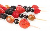 Fresh berry kebabs for healthy snack isolated on white