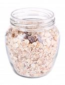 Homemade granola in glass jar, isolated on white