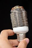 hand holding coin light bulb concept