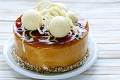 festive beautiful caramel biscuit cake decorated with white chocolate