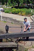 Man opening canal lock.