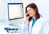 image of medical doctors  - Smiling medical doctor woman with computer and telephone - JPG