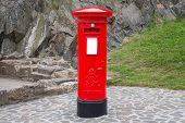 stock photo of postbox  - Typical red british postbox in the city - JPG