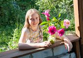 Girl At The Dacha With A Bouquet Of Flowers