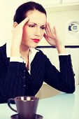 Beautiful business woman is pressing her head. Headache concept.