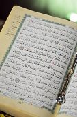stock photo of tasbih  - Islamic Book Holy Quran Open on Ramadan Aya Page - JPG