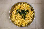 fried corn flakes with curry leaves used to make Indian savoury snacks