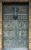 PARIS, FRANCE - NOV 10, 2012: Twelve apostles, entrance door of Saint-Vincent-de-Paul Church (design