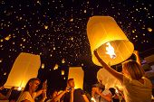 CHIANGMAI, THAILAND - NOV 16: People release sky lanterns to worship Buddha's relics during Yi Peng