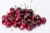 some of ripe red cherry isolated on white background