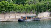 Houseboat On The River Seine In Paris, France