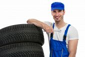 Young motor mechanic holding wrench ready to changes a tyre
