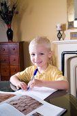 Boy Writing At Table