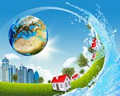 Earth, green grass, buildings and water