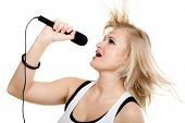 Girl Singer Singing To Microphone Isolated On White.