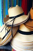 picture of panama hat  - Handmade traditional Panama Hats are stacked for sale at the outdoor craft market Ecuador - JPG