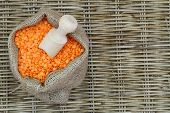 Red lentils in jute bag with copy space
